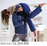 Купить «Armed man assaulting young woman at home», фото № 32264498, снято 15 декабря 2017 г. (c) Elnur / Фотобанк Лори