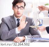 Купить «Businessmanbeing offered bribe for breaking law», фото № 32264502, снято 11 декабря 2017 г. (c) Elnur / Фотобанк Лори