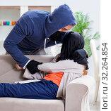 Купить «Armed man assaulting young woman at home», фото № 32264854, снято 15 декабря 2017 г. (c) Elnur / Фотобанк Лори