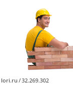 Купить «The handsome construction worker building brick wall», фото № 32269302, снято 5 ноября 2016 г. (c) Elnur / Фотобанк Лори