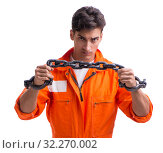 Купить «Prisoner with his hands chained isolated on white background», фото № 32270002, снято 18 августа 2017 г. (c) Elnur / Фотобанк Лори