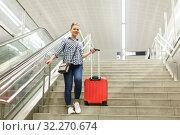 Купить «Girl coming down stairs in subway with suitcase», фото № 32270674, снято 27 апреля 2018 г. (c) Яков Филимонов / Фотобанк Лори