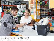 Купить «Girl standing at the counter in shop and consulting male customer», фото № 32270762, снято 17 мая 2018 г. (c) Яков Филимонов / Фотобанк Лори