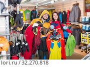 Купить «Young couple demonstrating tourist equipment», фото № 32270818, снято 8 марта 2017 г. (c) Яков Филимонов / Фотобанк Лори