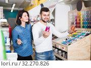 Купить «Male and female are deciding on materials for decorating house», фото № 32270826, снято 9 марта 2017 г. (c) Яков Филимонов / Фотобанк Лори