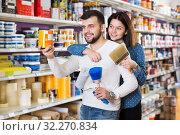 Купить «Couple deciding on best color scheme», фото № 32270834, снято 9 марта 2017 г. (c) Яков Филимонов / Фотобанк Лори