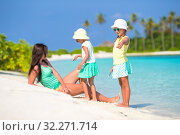 Young mother and two her little girls at exotic beach on sunny day. Стоковое фото, фотограф Дмитрий Травников / Фотобанк Лори