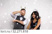 Купить «couple dancing at christmas or new year party», видеоролик № 32271818, снято 18 ноября 2019 г. (c) Syda Productions / Фотобанк Лори