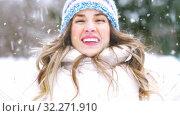 Купить «happy young woman throwing snow in winter forest», видеоролик № 32271910, снято 18 ноября 2019 г. (c) Syda Productions / Фотобанк Лори