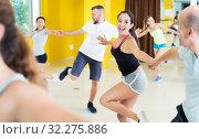 Купить «Young men and women dancing swing», фото № 32275886, снято 21 июня 2017 г. (c) Яков Филимонов / Фотобанк Лори
