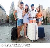 Купить «Four happy traveling young people with map», фото № 32275902, снято 22 июня 2017 г. (c) Яков Филимонов / Фотобанк Лори