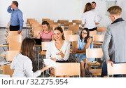 Купить «Student group having break between lessons», фото № 32275954, снято 25 июля 2018 г. (c) Яков Филимонов / Фотобанк Лори