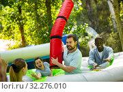 Team of friends playing with inflatable sticks on the trampoline. Стоковое фото, фотограф Яков Филимонов / Фотобанк Лори