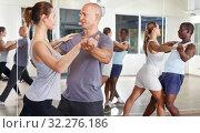 People exercising waltz movements in pairs. Стоковое фото, фотограф Яков Филимонов / Фотобанк Лори