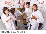 Купить «Young people in lost room with bloody walls», фото № 32276334, снято 8 октября 2018 г. (c) Яков Филимонов / Фотобанк Лори