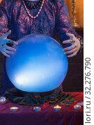 Купить «Hands of fortune teller with illuminated crystal ball», фото № 32276790, снято 2 августа 2019 г. (c) Майя Крученкова / Фотобанк Лори
