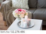 Купить «candles burning on table and flowers at cozy home», фото № 32278486, снято 11 апреля 2019 г. (c) Syda Productions / Фотобанк Лори