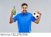 Купить «football fan with soccer ball celebrating victory», фото № 32278554, снято 8 сентября 2019 г. (c) Syda Productions / Фотобанк Лори