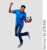 Купить «man or football fan with soccer ball jumping», фото № 32278626, снято 8 сентября 2019 г. (c) Syda Productions / Фотобанк Лори