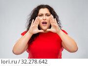 Купить «worried woman in red dress calling», фото № 32278642, снято 15 сентября 2019 г. (c) Syda Productions / Фотобанк Лори