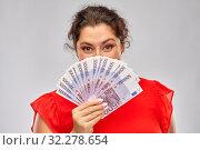 Купить «happy woman holding euro money banknotes», фото № 32278654, снято 15 сентября 2019 г. (c) Syda Productions / Фотобанк Лори