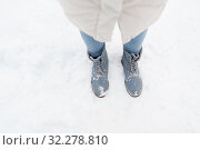 Купить «female feet in winter shoes on snow from top», фото № 32278810, снято 20 января 2019 г. (c) Syda Productions / Фотобанк Лори