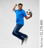 Купить «man or football fan with soccer ball jumping», фото № 32278886, снято 8 сентября 2019 г. (c) Syda Productions / Фотобанк Лори
