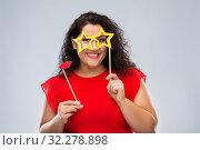 Купить «funny woman with star shaped glasses and red lips», фото № 32278898, снято 15 сентября 2019 г. (c) Syda Productions / Фотобанк Лори