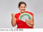 Купить «happy woman holding hundreds of money banknotes», фото № 32278906, снято 15 сентября 2019 г. (c) Syda Productions / Фотобанк Лори
