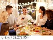 Купить «happy family having dinner party at home», фото № 32278954, снято 15 декабря 2018 г. (c) Syda Productions / Фотобанк Лори