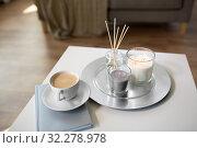 Купить «coffee, candles and aroma reed diffuser on table», фото № 32278978, снято 11 апреля 2019 г. (c) Syda Productions / Фотобанк Лори