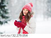 Купить «happy young woman with tea cup in winter park», фото № 32279054, снято 29 января 2019 г. (c) Syda Productions / Фотобанк Лори