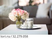 Купить «aroma reed diffuser, candle and flowers on table», фото № 32279058, снято 11 апреля 2019 г. (c) Syda Productions / Фотобанк Лори