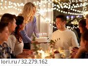 Купить «happy family with cake having birthday party», фото № 32279162, снято 15 декабря 2018 г. (c) Syda Productions / Фотобанк Лори
