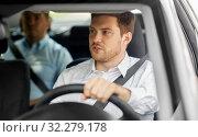 Купить «male driver driving car with passenger», фото № 32279178, снято 25 августа 2019 г. (c) Syda Productions / Фотобанк Лори