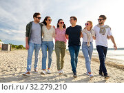 Купить «happy friends walking along summer beach», фото № 32279210, снято 31 августа 2019 г. (c) Syda Productions / Фотобанк Лори