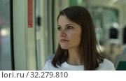 Купить «Portrait of young woman standing in underground carriage», видеоролик № 32279810, снято 19 сентября 2019 г. (c) Яков Филимонов / Фотобанк Лори