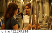 Купить «Two girlfriends talk in a subway car», видеоролик № 32279814, снято 23 сентября 2019 г. (c) Яков Филимонов / Фотобанк Лори