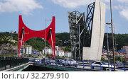 Купить «View of bridge of La Salve over the nervion river at Bilbao, Spain», видеоролик № 32279910, снято 16 июля 2019 г. (c) Яков Филимонов / Фотобанк Лори