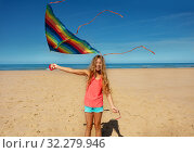 Купить «Beautiful girl stand on the beach with color kite», фото № 32279946, снято 3 августа 2019 г. (c) Сергей Новиков / Фотобанк Лори