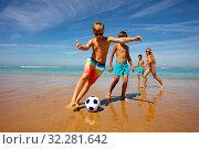 Children play soccer ball on a beach near the sea. Стоковое фото, фотограф Сергей Новиков / Фотобанк Лори