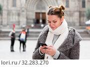Купить «girl using mobile phone in scarf», фото № 32283270, снято 11 ноября 2017 г. (c) Яков Филимонов / Фотобанк Лори