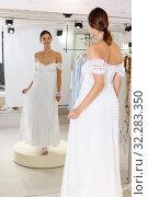 Купить «Woman dressed in white gown», фото № 32283350, снято 17 сентября 2018 г. (c) Яков Филимонов / Фотобанк Лори