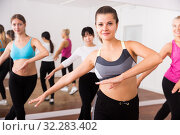 Купить «Ordinary active females exercising dance moves», фото № 32283402, снято 21 сентября 2019 г. (c) Яков Филимонов / Фотобанк Лори