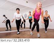 Купить «Ordinary active females exercising dance moves», фото № 32283410, снято 21 сентября 2019 г. (c) Яков Филимонов / Фотобанк Лори