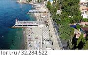 Купить «Yalta, Crimea -June 27. 2019 The Famous city paid Massandra beach», видеоролик № 32284522, снято 17 октября 2019 г. (c) Володина Ольга / Фотобанк Лори