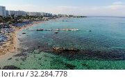 Protaras, Cyprus - Oct 11. 2019. The Famous Vrissiana Beach -a beautiful public Beach is part of Sunrise beach. Редакционное видео, видеограф Володина Ольга / Фотобанк Лори