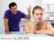 Купить «Upset woman at table with disgruntled man behind», фото № 32284942, снято 5 июня 2020 г. (c) Яков Филимонов / Фотобанк Лори