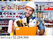 Купить «foreman holding basket with tools», фото № 32284966, снято 13 сентября 2017 г. (c) Яков Филимонов / Фотобанк Лори