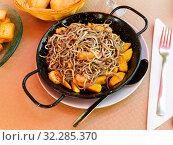 Купить «Plate of tasty fried baby eels and prawns with potatoes», фото № 32285370, снято 15 июля 2019 г. (c) Яков Филимонов / Фотобанк Лори